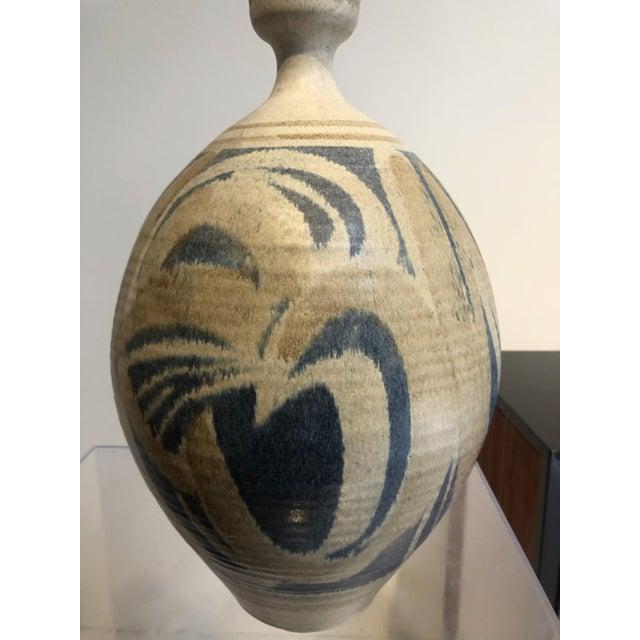 This is a large, bold stoneware vase represents California Mid-Century design, by Wishon Harrell Studio Pottery of La...