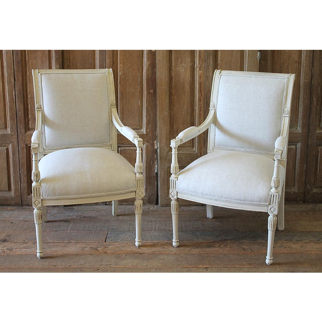 Pair of painted arm chairs in our oyster white finish, with subtle distressed edges, and finished with an antique glazed...
