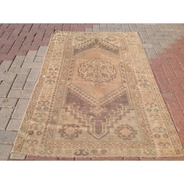 A one of a kind hand made Turkish Oushak rug. This gorgeous hand knotted area rug is made in 1940's by Anatolian tribals....