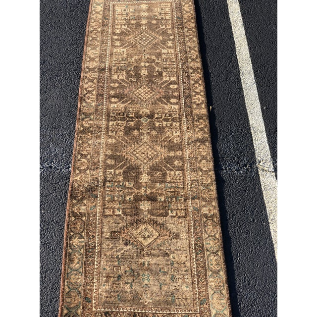 This is a vintage Persian rug. The piece is from the 1950s.