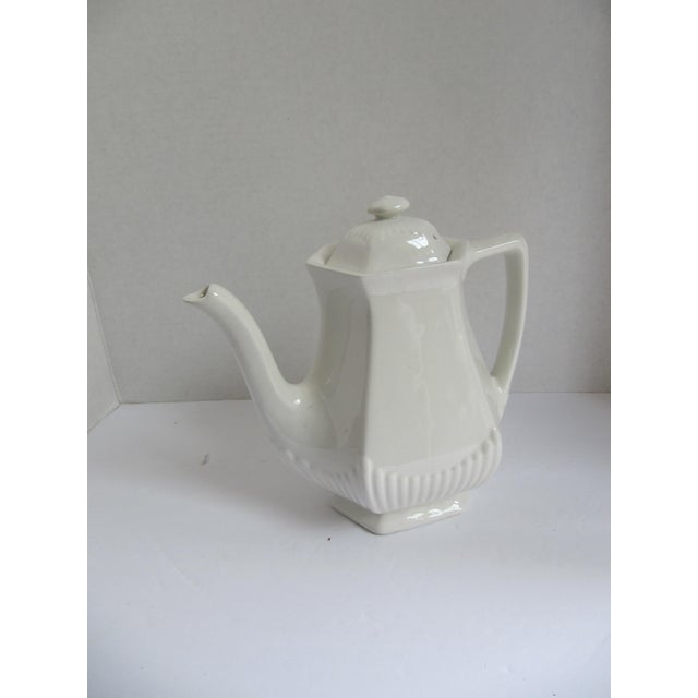 Add this beautiful Adam's vintage white ironstone coffeepot to your collection or use for everyday. Marked on the bottom.