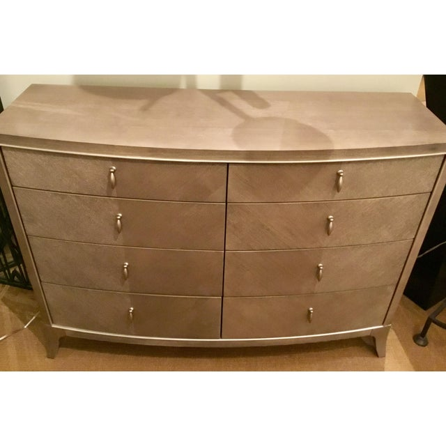 Chic modern Caracole Avondale single dresser finished in a warm champagne silver with metalic finished door fronts, silver...