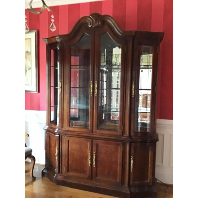 Beautiful traditional Bernhardt mahogany breakfront china cabinet. Unusually detailed hand carved shell at center top of...