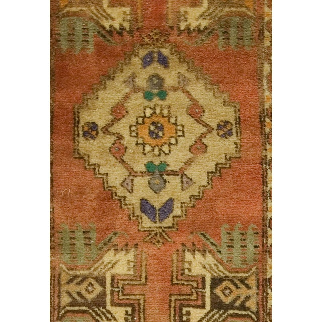 Offered is a vintage Oushak Yastik rug. This handwoven beauty features a medallion motif in soft tones of orange and mustard.