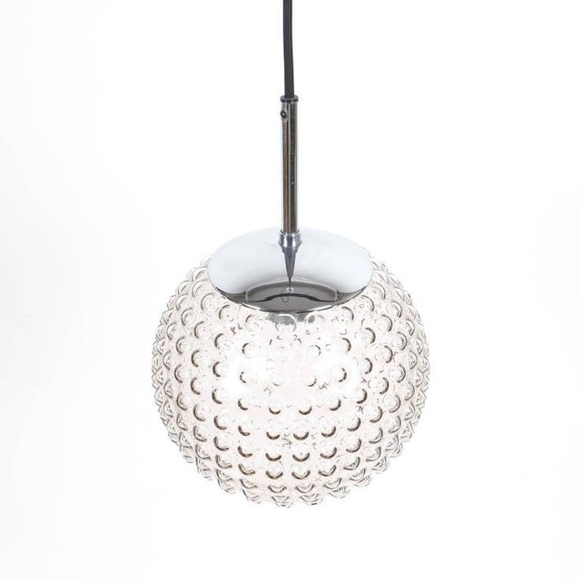 Beautiful bubble glass pendants by Staff, Germany (five identical pieces available) featuring chromed hardware and black...