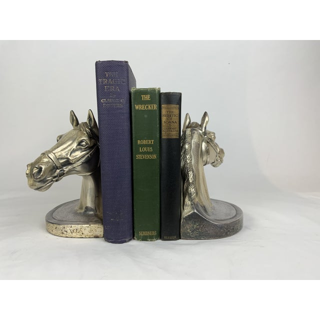 These gorgeous horse head bookends are hand cast and have an elegant time worn silver tone finish. The strength and...