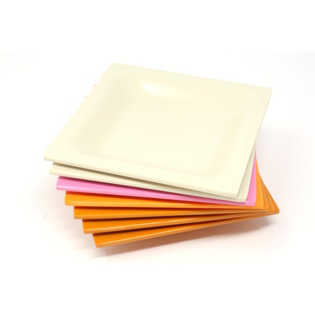 A set of seven square melamine dishes - 3 dark orange, 2 beige, one bright orange, and one pink. Good vintage condition....