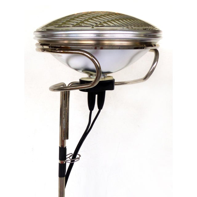 Offered for sale is a Toio floor lamp by the Achille & Pier Giacomo Castiglioni for Flos Lighting. This unusual lamp has...