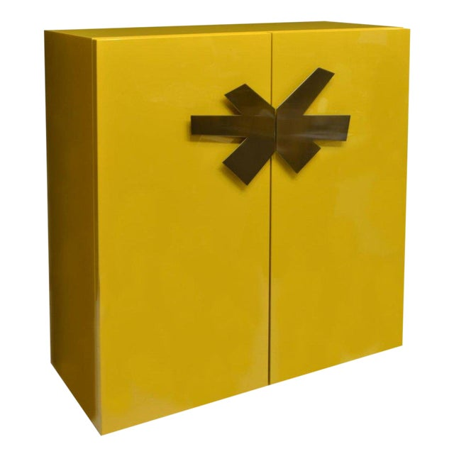 Mid-Century Modern Yellow High Gloss Lacquered Cabinet With Large Brass Asterisk Pulls For Sale