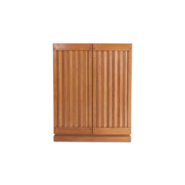 Brutalist Oak storage piece with geometrical door paneling. Would fit well in a brutalist, minimalist interior as in a...