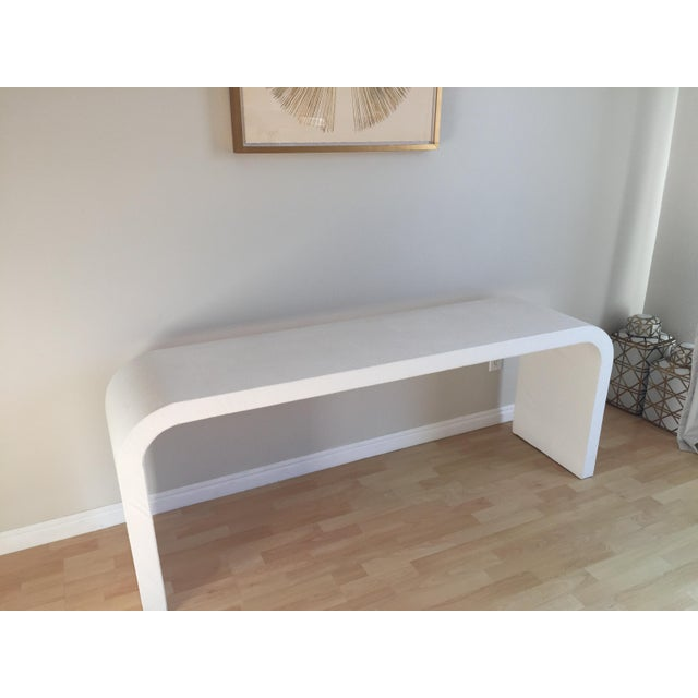 High end console wrapped in white faux ostrich leather. Good clean vintage condition. There are a total of three tears,...