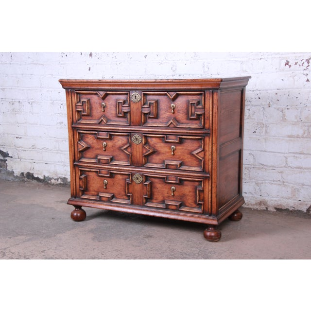 Offering a very nice and unique solid oak three drawer dresser or bachelor chest The chest has nice ornate carved details...