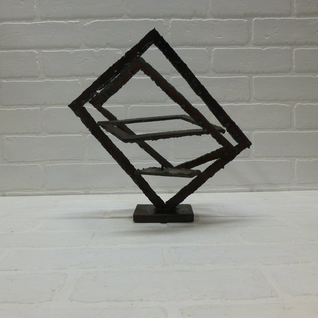 "Brutalist hand forged 3 dimensional sculptural candle holder from the 1960s. Measures 13"" tall by 13"" wide and 8"" deep,..."