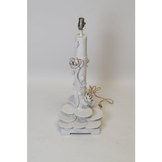 Large white porcelain lamp with Bamboo and Lotus Flower design. Fun, Mid Century Statement piece.