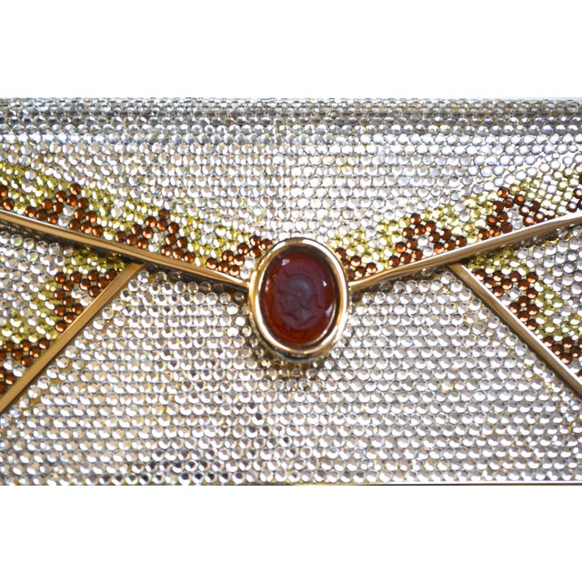 Circa 1970s glam Swarovski crystal and carnelian intaglio clutch with snake chain adjustable strap. Signed inside. Gold...