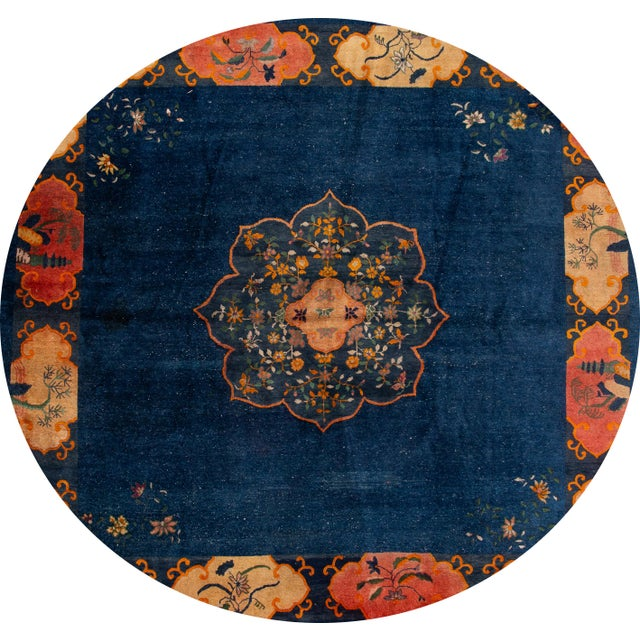 Beautiful antique Chinese Art Deco rug, hand knotted wool with a dark blue field, tan frame and a multi-color accents in a...