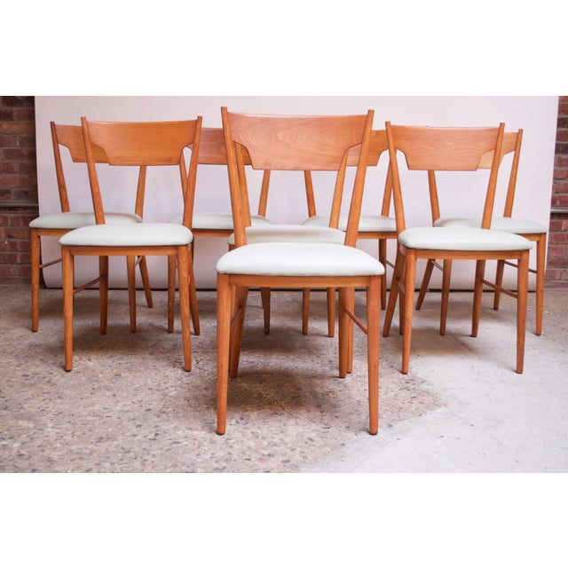 Set of eight stained maple dining chairs designed by Paul McCobb for his Perimeter Group and manufactured by Winchendon...