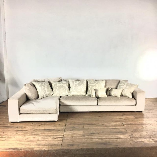 Bearing a label by the maker. With throw pillows. In two pieces. Brand is Minotti. Dimensions (in): 125.0 W x 62.0 D x...