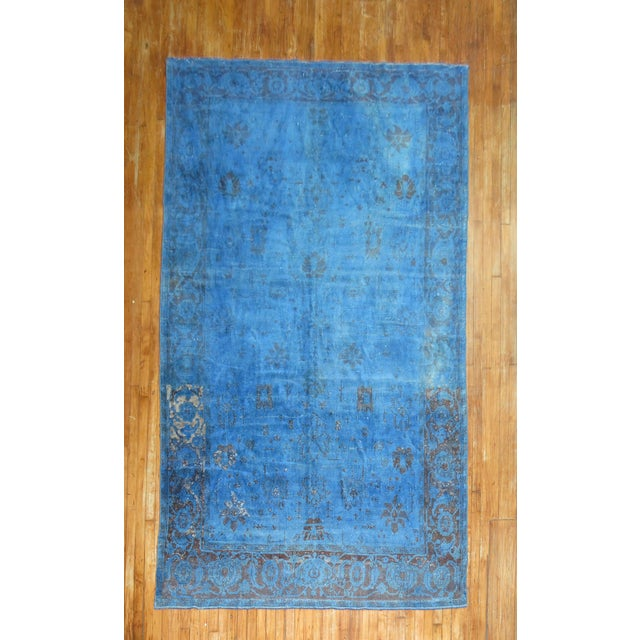 A one of a kind vintage Turkish rug that has been overdyed to a predominant cobalt blue color. The weave on this piece is...