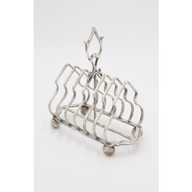A superb antique English silverplated six slice toast rack, circa 1900. Maker's mark and hallmarks on reverse. This fine...