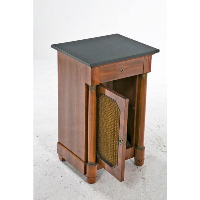 A rare and useful French Empire style mahogany cabinet made in France during the first quarter of the 20th century....