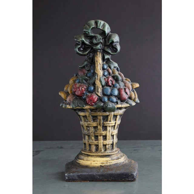 Lovely late 19th century large cast iron hand painted polychrome flower bouquet in basket doorstop with it's original...