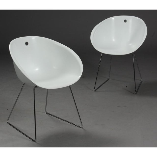 Four chairs, model Gliss 920, by Claudio Dondoli & Marco Pocci. Manufactured by Pedrali. Pedrali Gliss 921 armchair with...