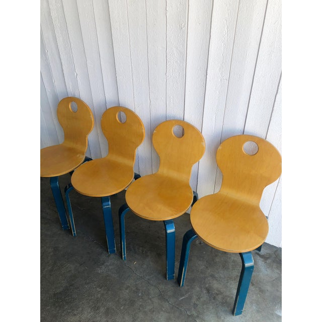 Fun schoolhouse style two toned wooden dining chairs, sold as a set of 4. Beautiful rounded edges and smooth lines, each...