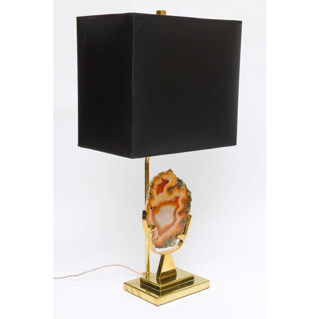 Brass table lamp with agate. Signed, Willy Daro. Wired for the U.S. and takes 2 max. 60 wattage light bulbs. Shade not...