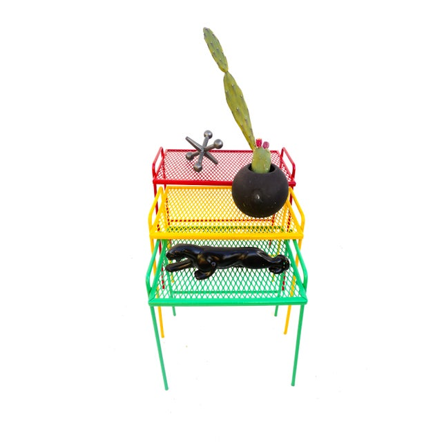 """And a pop of color to your patio or dress up your deck with this set of three primary red, yellow, and green """"One Love""""..."""