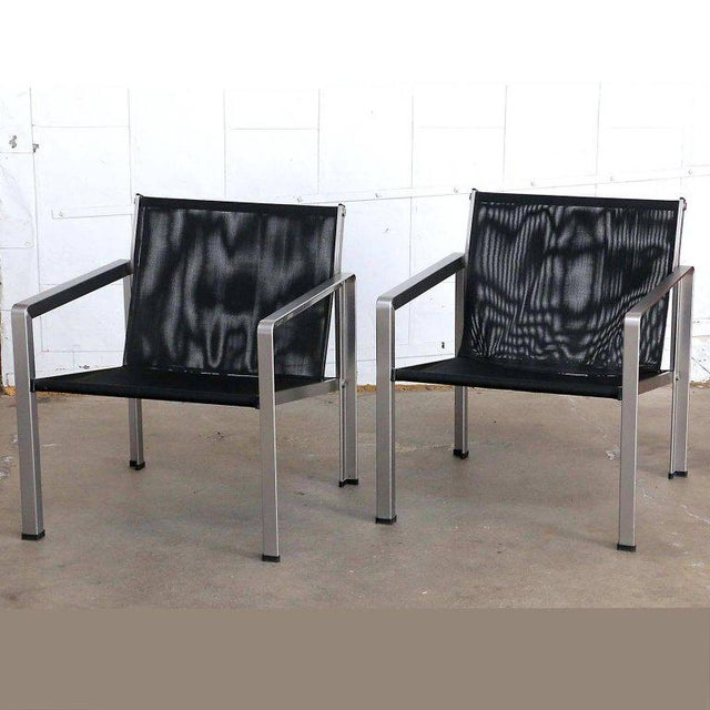 Rare pair of Giuseppe Raimondi design aluminum modernist lounge or cube chairs made in Italy. Each constructed from flat-...