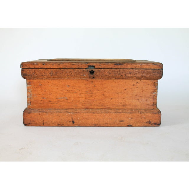 Antique pine carpenter's tool chest. Beautiful patina to wood and handcrafted dovetail work. Painted interior. No key...