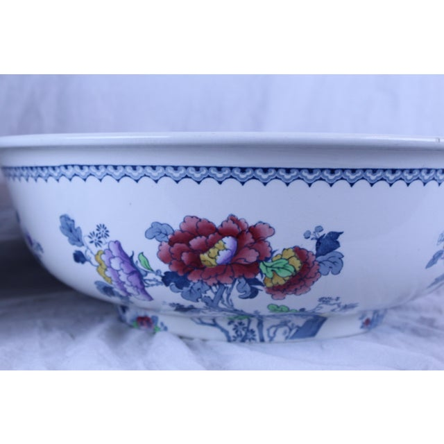 Losol Ware pitcher and basin pair. Painted china with blue and pink floral details. Perfect for a planter.