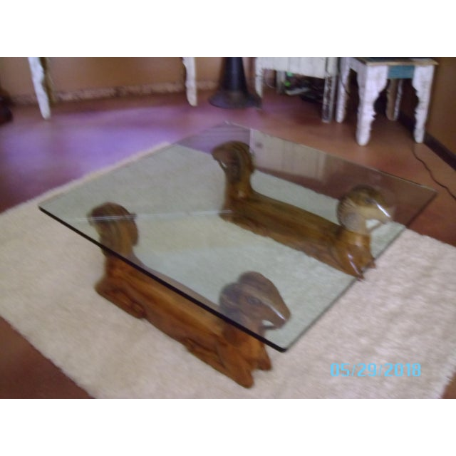 An Early to Mid 20th Century - Glass Top Recumbent Goat Coffee Cocktail Table - This piece is comprised of two juxtapose...