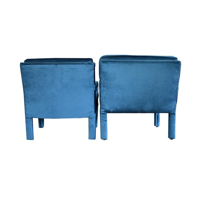 Pair of midcentury blue velvet Milo Baughman style armchairs. Newly upholstered in a buttery soft blue velvet fabric....