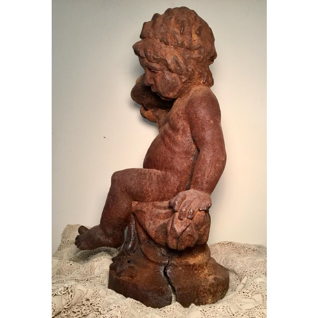 This antique cherub would make a statement anywhere you placed him. Perfect for that special spot in your garden or home....