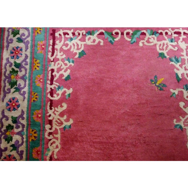 Handmade vintage ARt Deco Chinese rug in fuchsia colour and with all-over design. The rug is from 1930s, in original good...