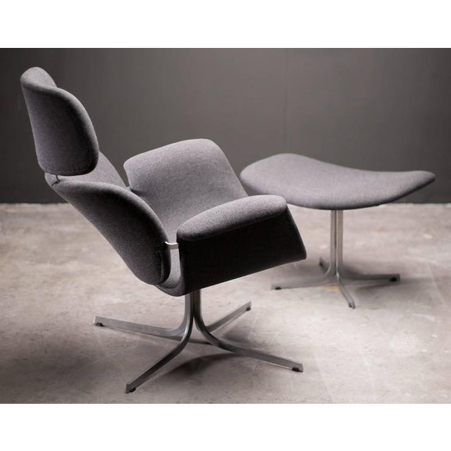 Model F545, also known as Big Tulip chair. Very comfortable lounge chair with rare matching footstool by Pierre Paulin for...