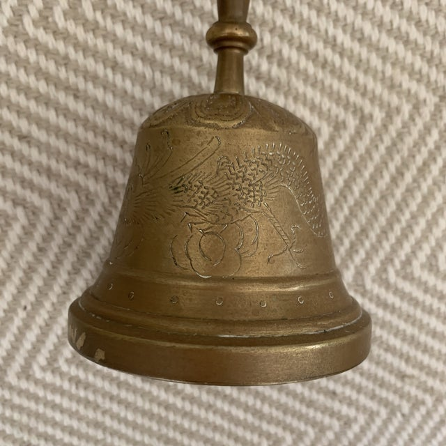"""Made from solid brass this decorative brass bell measures 8.5"""" tall 3.5"""" width."""