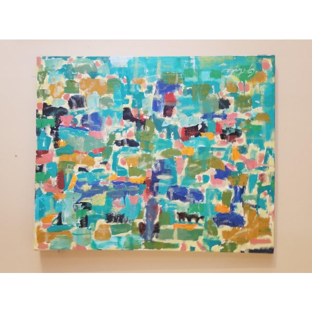This is a vintage abstract painting with vivid blues and greens as well as a mix of other colors. It is signed with a...