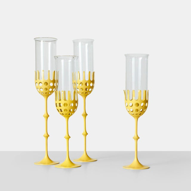 A set of hurricane lamps painted yellow with glass shades. Height adjustable with interchangeable links that can be moved...