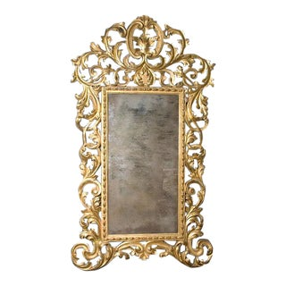 An Exuberant Italian Baroque Giltwood Mirror For Sale