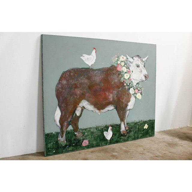Monumental oil on canvas painting by Ira Yeager (b. 1938) of a French cow with chickens wearing a colorful wreath of...