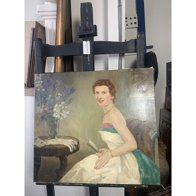 Beautiful portrait painting of a seated woman in a gorgeous dress. This oil on canvas has gorgeous patina at nail heads....