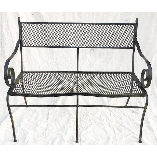 """Handsome Salterini black iron garden bench with a fantastic """"as found"""" natural mossy green patina, c. 1950s. Bench has..."""