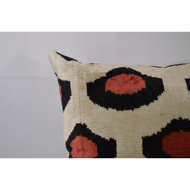 Red and Black dot patterned pillow with ivory colored background and backing. Faux-down insert.