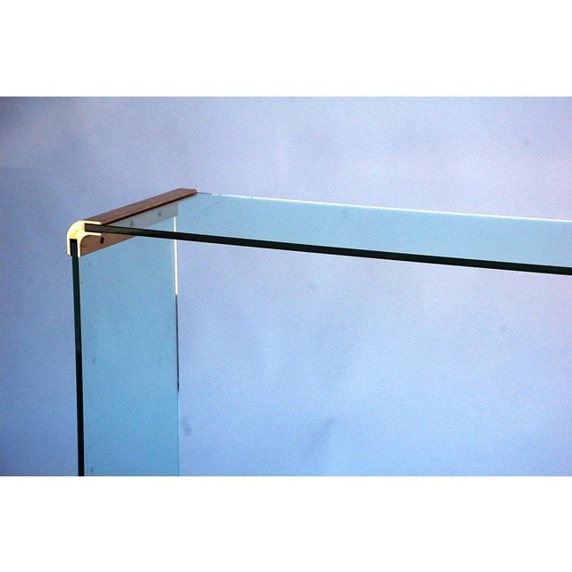 This listing is for a glass and gilt bronze console/sofa table by Pace Collection.
