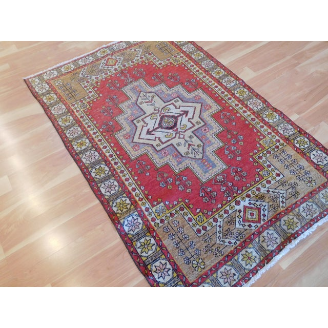 This is a vintage old Turkish Rug, with warmer color combination.