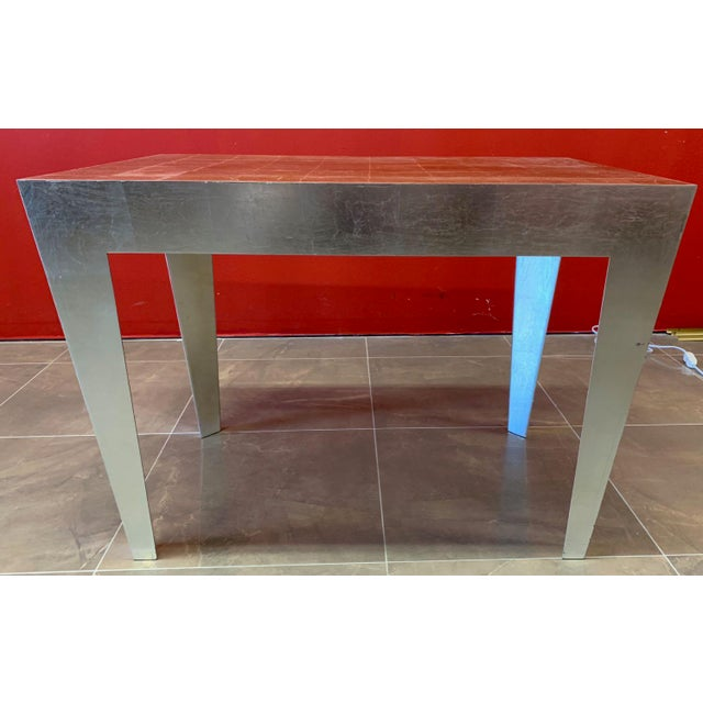 Completely unique steel accent tables with silver leaf and gold lead finish. Tables are made of steel with triangular,...
