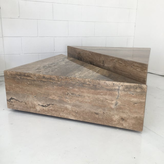 Two piece coffee table executed in light brown travertine. Items are well built and very heavy, they both sit on three...